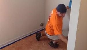 Mold Cleanup Technician On The Job
