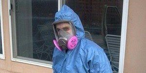 Technician With Mold Removal Gear and Tools
