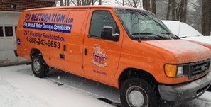 Water Damage Restoration Van At Residential Job Site